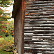 Decaying siding on an old storage building in Bridgton, ME