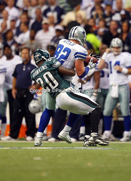 IRVING, TX - SEPTEMBER 15:  Tight end Jason Witten #82 of the Dallas Cowboys catches a pass and tries to elude a tackle by free safety Brian Dawkins #20 of the Philadelphia Eagles at Texas Stadium on September 15, 2008 in Irving, Texas. The Cowboys defeated the Eagles 41-37. ©Paul Anthony Spinelli *** Local Caption *** Jason Witten;Brian Dawkins