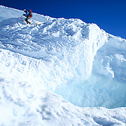 A climber makes the dangerous descent during a summit of Mount Rainier on June 30, 2015. The iconic Pacific Northwest volcano is a popular challenge for mountaineers.  (Joshua Trujillo, seattlepi.com)