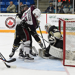 "TRENTON, ON  - MAY 4,  2017: Canadian Junior Hockey League, Central Canadian Jr. ""A"" Championship. The Dudley Hewitt Cup. Game 6 between Trenton Golden Hawks and the Dryden GM Ice Dogs. Nic Noseworthy #27 of the Dryden GM Ice Dogs battles for control with Chays Ruddy #4 and Elliot Gerth #30 of the Trenton Golden Hawks during the first period.<br /> (Photo by Andy Corneau / OJHL Images)"