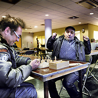Nederland, Amsterdam , 8 december 2012..Een dakloze strekt zich uit in de ontbijtzaal van het voormalige kantorenpand aan de Laan van Vlaanderen, dat tijdelijk is ingericht als daklozenopvang vanwege de vrieskou..Verwacht wordt dat dit weekend zo'n 220 daklozen zich zullen aanmelden om hier te overnachten..Foto:Jean-Pierre Jans