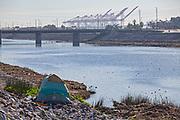 Homless tent along the Los Angeles River, Willow Street, Long Beach, Califortnia, USA,
