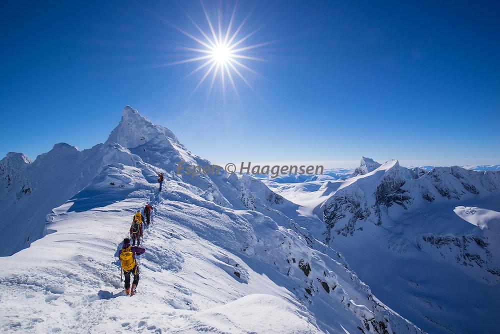 Climbers on a row towards Store Dyrhaugstind.