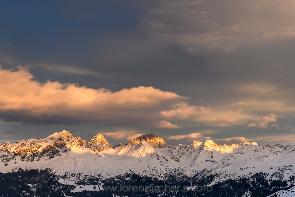 The group of the Bergüner Stöcke with the peaks Piz Mitgel, Corn da Tinizong and Piz Ela in the last sunlight of the day, Parc Ela, Grisons, Switzerland