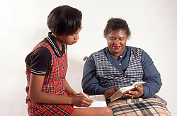 Woman with disability; who is wheelchair user; helping teenage daughter with homework,
