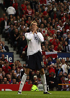 Photo: Paul Thomas.<br /> England v Macedonia. UEFA European Championships 2008 Qualifying. 07/10/2006.<br /> <br /> Peter Crouch of England knows he should have done better.