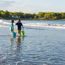 A young boy and girl plays at Seapoint Beach in Kittery, Maine.