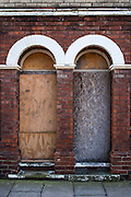 Boarded up front doors of derelict houses in Middlesborough town centre, North Yorkshire, United Kingdom.
