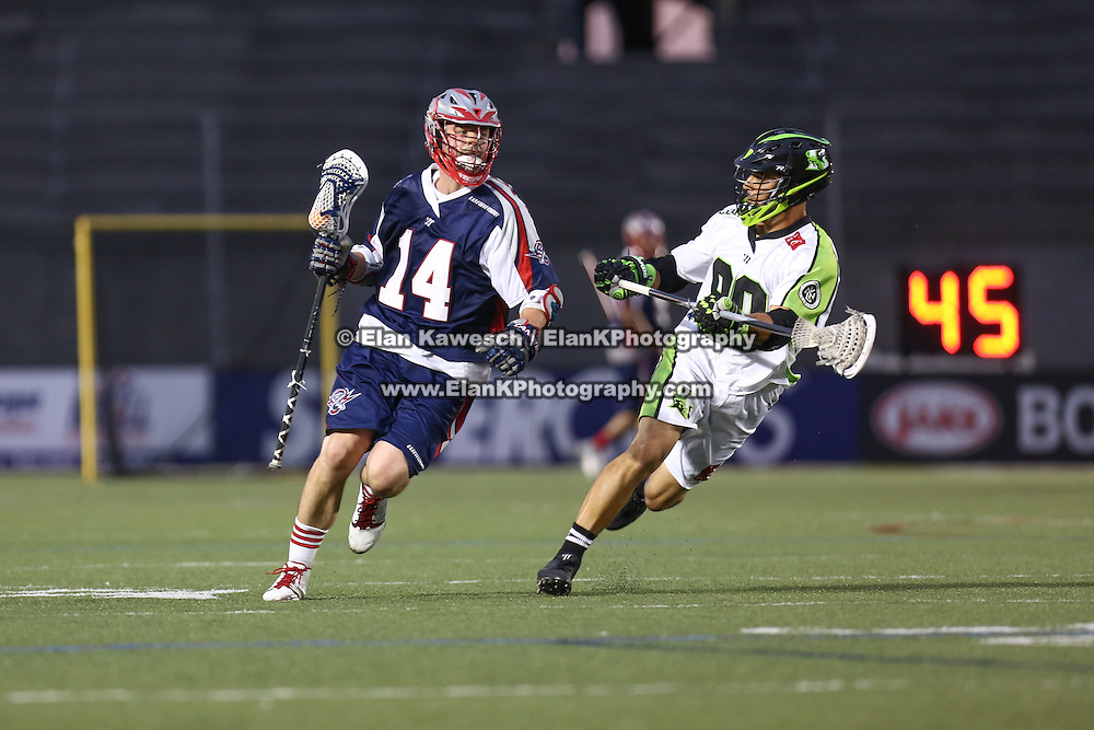 Ryan Boyle #14 of the Boston Cannons runs with the ball during the game at Harvard Stadium on July 19, 2014 in Boston, Massachusetts. (Photo by Elan Kawesch)