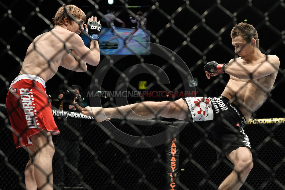 """MANCHESTER, ENGLAND, NOVEMBER 14, 2009: Nick Osipczak and Matthew Riddle during """"UFC 105: Couture vs. Vera"""" inside the MEN Arena in Manchester, United Kingdom."""
