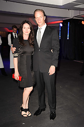 RUPERT PENRY-JONES and DERVLA KIRWAN at a party to celebrate 150 years of TAG Heuer held at the car park at Selfridge's, London on 15th September 2010.