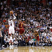 24 January 2012: Miami Heat small forward LeBron James (6) takes a jumpshot over Cleveland Cavaliers point guard Kyrie Irving (2) during the Miami Heat 92-85 victory over the Cleveland Cavaliers at the AmericanAirlines Arena, Miami, Florida, USA.