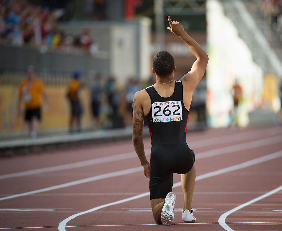 Men's 200 meter dash-finals- Andre Degrasse-Canada-gold medal celebrates during athletics competition at the 2015 PanAm Games in Toronto.