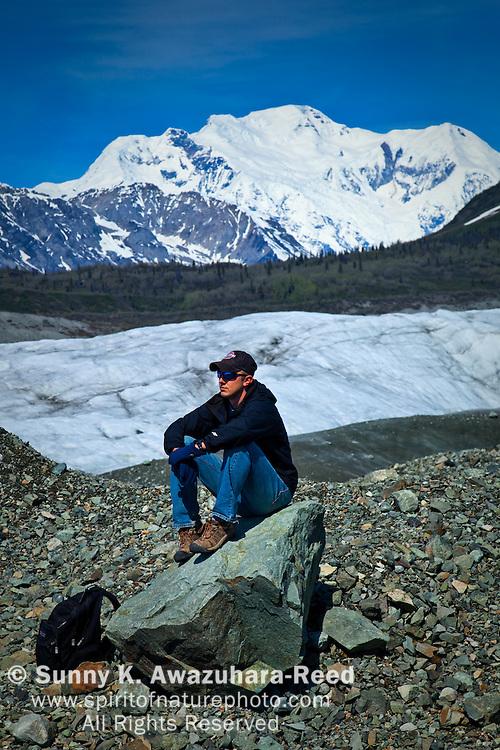 Hiking on Root Glacier, Mt. Blackburn, model released, Wrangell - St. Elias Park, Alaska
