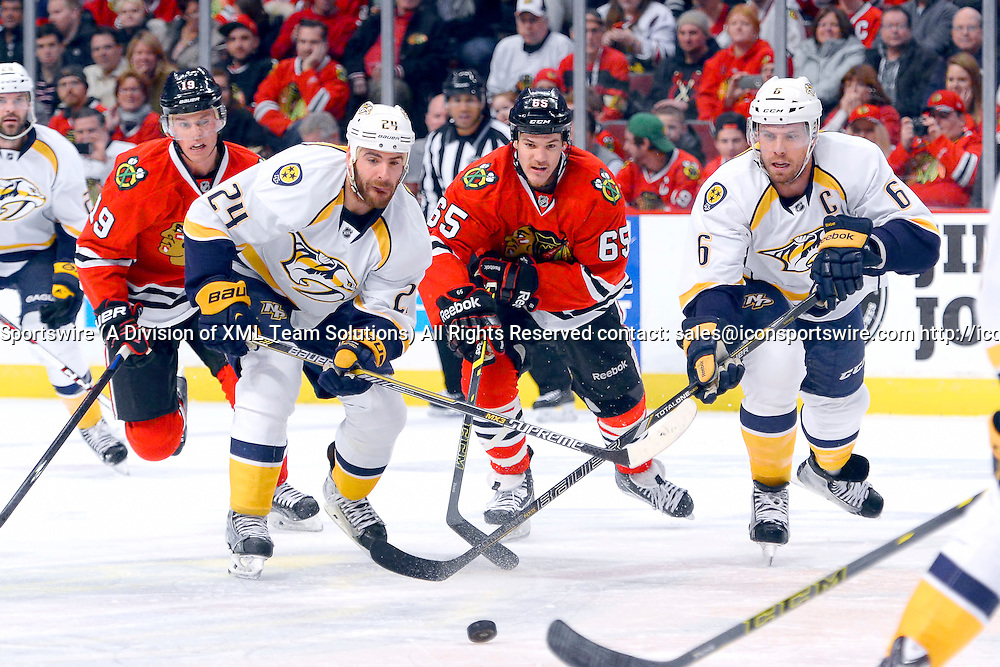 29 December 2014: Chicago Blackhawks Center Andrew Shaw (65) [8702] battles with Nashville Predators Right Wing Eric Nystrom (24) [2868] and Nashville Predators Defenceman Shea Weber (6) [3494] in action during a game between the Nashville Predators and the Chicago Blackhawks at the United Center, in Chicago, IL.