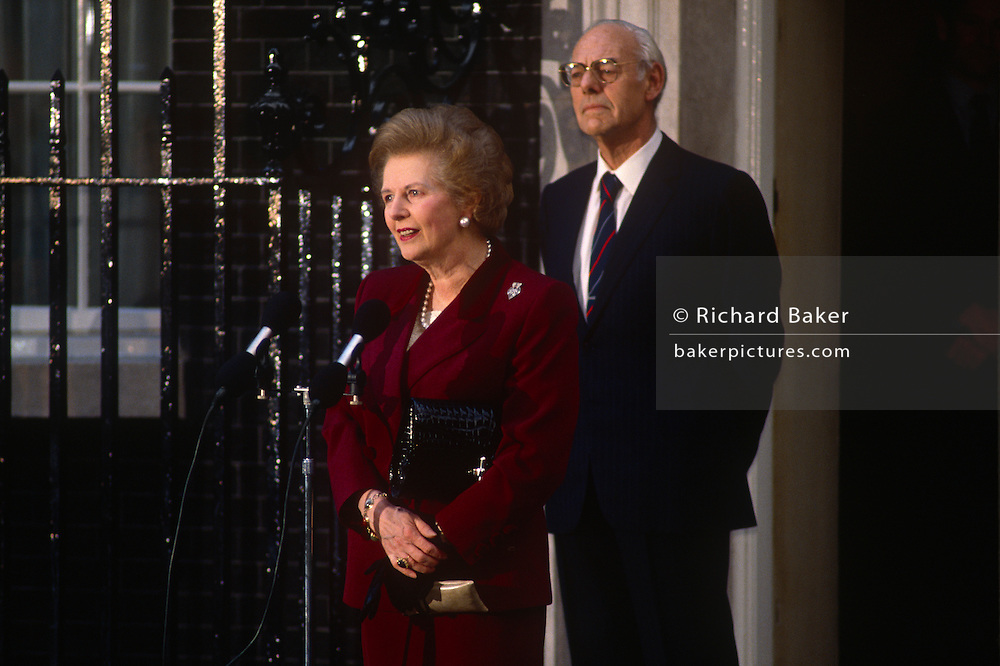 British Prime Minister, Margaret Thatcher's political career of 11 years ends emotionally on the steps of 10 Downing Street after being deposed in a leadership challenge, on 28th November 1990 in London, England. Standing close behind her is Thatcher's husband and lifelong confidente, Dennis.