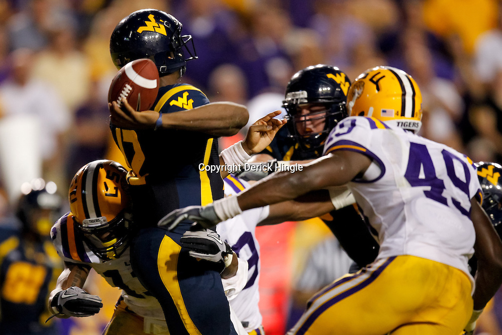 Sep 25, 2010; Baton Rouge, LA, USA; LSU Tigers linebacker Kelvin Sheppard (11) pressures West Virginia Mountaineers quarterback Geno Smith (12) on a pass during the second half at Tiger Stadium. LSU defeated West Virginia 20-14.  Mandatory Credit: Derick E. Hingle