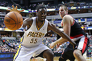 March 13, 2012; Indianapolis, IN, USA; Indiana Pacers center Roy Hibbert (55) watches the ball go out of bounds as Portland Trail Blazers center Joel Przybilla (10) defends at Bankers Life Fieldhouse. Mandatory credit: Michael Hickey-US PRESSWIRE