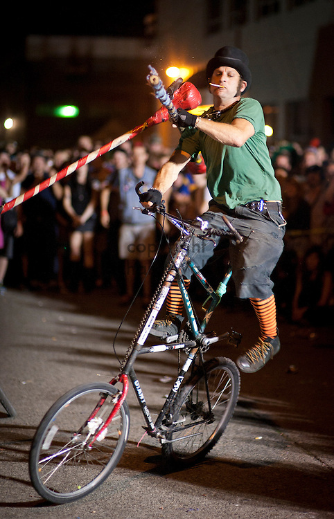 2011 August 05 - A man is knocked off his bike at the tall bike jousting at the Dead Baby Downhill party in Georgetown, Seattle, WA. Photo by Richard Walker