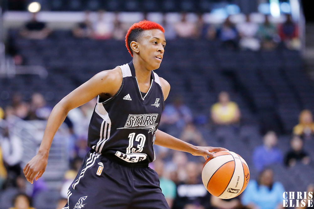 25 May 2014: San Antonio Stars guard Danielle Robinson (13) brings the ball up court during the Los Angeles Sparks 83-62 victory over the San Antonio Stars, at the Staples Center, Los Angeles, California, USA.