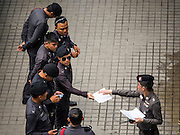 "26 JUNE 2015 - BANGKOK, THAILAND:  Thai police in front of the Foreign Correspondents' Club of Thailand after they cancelled the release of a Human Rights Watch (HRW) report, ""Persecuting 'Evil Way' Religion: Abuses against Montagnards in Vietnam"", at the Foreign Correspondents' Club of Thailand (FCCT) in Bangkok Friday morning. The report made no mention of the human rights situation in Thailand. The Thai Ministry of Foreign Affairs (MFA) contacted HRW Thursday afternoon and asked them to cancel the program because it was a ""sensitive"" matter that could impact on Thai-Vietnam relations. HRW told the MFA that they would go ahead with the report's release. Friday morning, before the report was scheduled to be released, Thai police officers arrived at the FCCT and cancelled the event. Phil Robertson, deputy director of Human Rights Watch's Asia division, said, ""By stepping in to defend a neighboring state's human rights violations against a group of its people and interrupting a scheduled press conference, Thailand's military junta is violating freedom of assembly and demonstrating its contempt for freedom of the press.""      PHOTO BY JACK KURTZ"