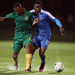 Wayde Jooste of Golden Arrows tackled by Lebohang Maboe of Maritzburg Utd during the 2016 Premier Soccer League match between Maritzburg Utd and Golden Arrows held at the Harry Gwala Stadium in Pietermaritzburg, South Africa on the 28th October 2016<br /> <br /> Photo by:   Steve Haag / Real Time Images