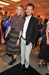 LAURA BAILEY and MATTHEW WILLIAMSON at a party to celebrate the launch of the Vogue Fashion's Night Out held at Mulberry, Bond Street, London on 6th September 2012.