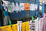 Safiye Çinar, 55, hangs laundry outside her Golden Horn area home, Istanbul, Turkey.
