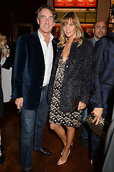 TIM & MALIN JEFFERIES at a party to celebrate the launch of the Maison Assouline Flagship Store at 196a Piccadilly, London on 28th October 2014.  During the evening Valentino signed copies of his new book - At The Emperor's Table.