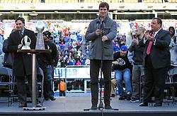 Feb 7, 2012; East Rutherford, NJ, USA; NJ Gov. Chris Christie (right) cheers for New York Giants quarterback Eli Manning during the New York Giants Super Bowl XLVI Rally at MetLife Stadium.