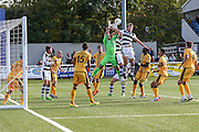 Sutton United's goalkeeper Ross Worner comes for a cross and misses during the The FA Cup 4th qualifying round match between Sutton United and Forest Green Rovers at Gander Green Lane, Sutton, United Kingdom on 15 October 2016. Photo by Shane Healey.