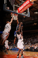 Duke guard Nolan Smith #2 dunks the ball over Southern Illinois center Nick Evans #50 and Southern Illinois guard Wesley Clemmons #24 as Duke beat Southern Illinois 83-58 to advance to the Championship of the 2008 2K Sports Classic at Madison Square Garden in New York.
