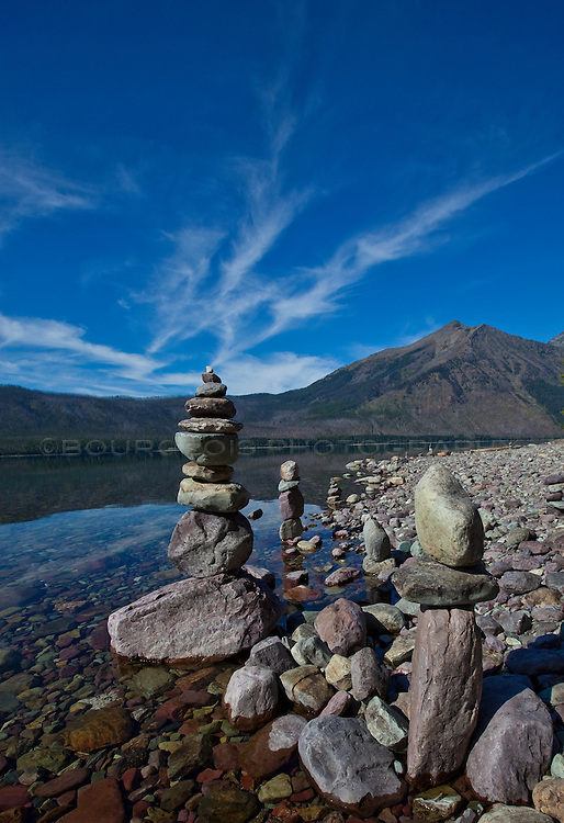 Rock cairns on waters edge