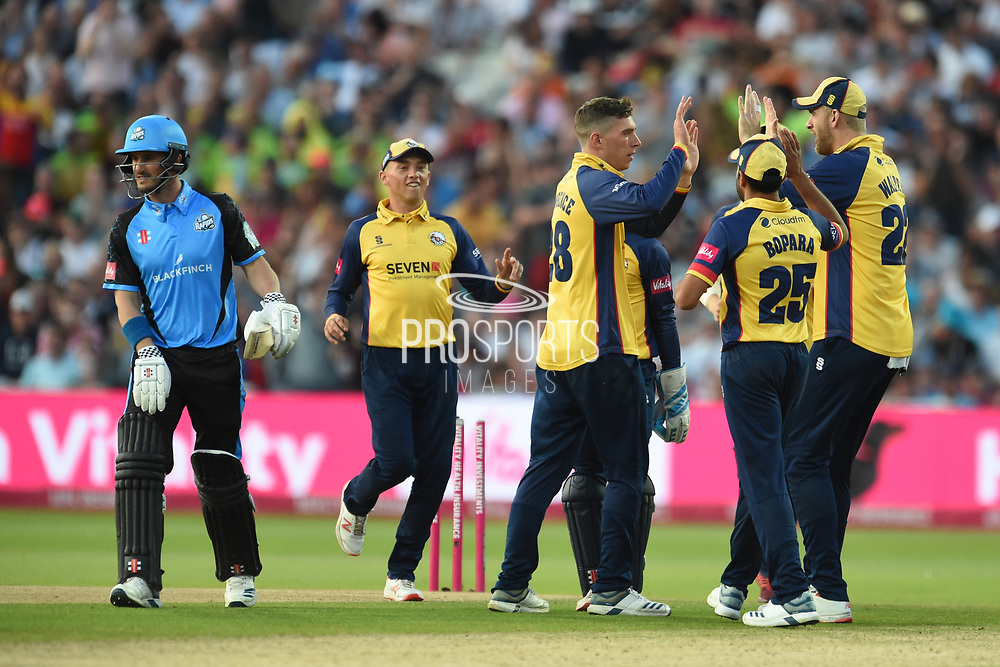 Daniel Lawrence, Paul Walter and Ravi Bopara of Essex Eagles celebrate the wicket of Hamish Rutherford during the Vitality T20 Finals Day 2019 match between Worcestershire County Cricket Club and Essex County Cricket Club at Edgbaston, Birmingham, United Kingdom on 21 September 2019.