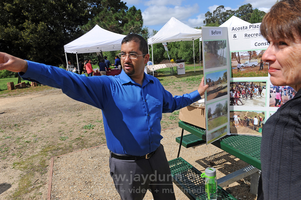 At the opening on Sunday, April 24th of the new Acosta Plaza Recreation Area in east Salinas, CA, Joel Hernandez from the Center for Community Advocacy points out some of the area's many features to Cary Siegfried, director of the city's library and community services department.