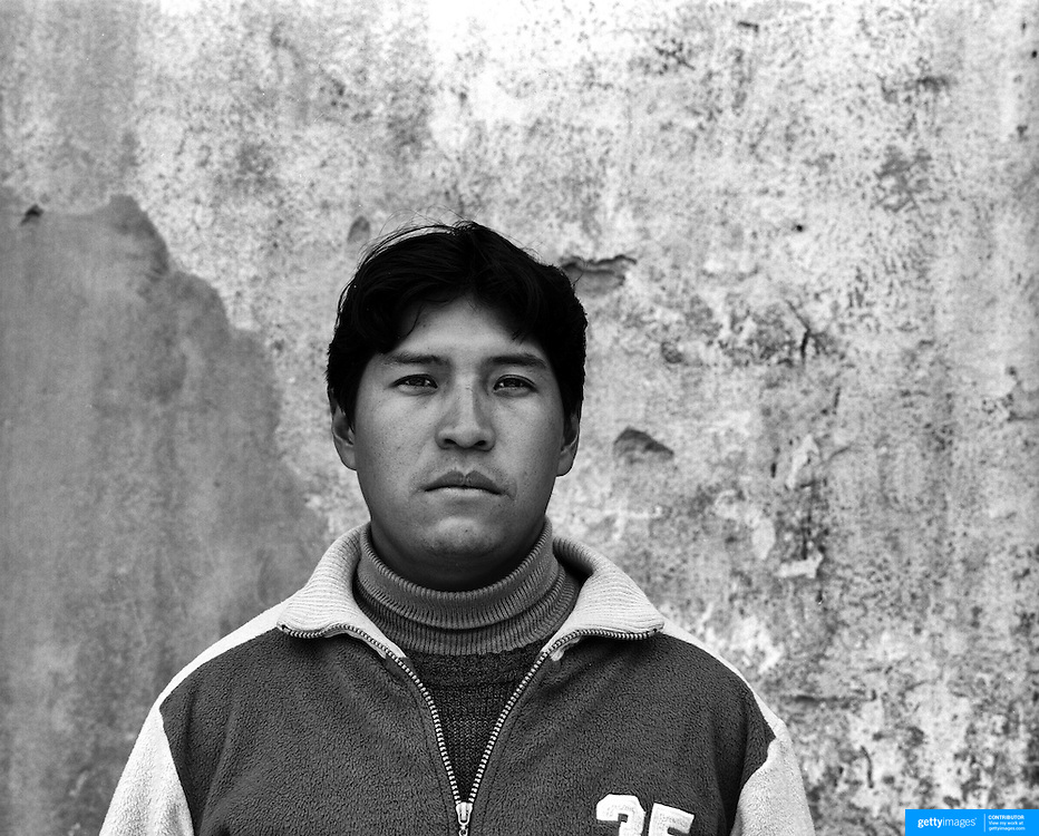 Reynaldo Ramirez Uzeda, 31, former miner now tourist guide. Potosi. Bolivia..Sitting at 4,090M (13,420 Feet) above sea level the small mining community of Potosi, Bolivia is one of the highest cities in the world by elevation and sits ?sky high? in the hills of the land locked nation. Overlooking the city is the infamous mountain, Cerro Rico (rich mountain), a mountain conceived to be made of silver ore. It was the major supplier of silver for the spanish empire and has been mined since 1546, according to records 45,000 tons of pure silver were mined from Cerro Rico between 1556 and 1783, 9000 tons of which went to the Spanish Monarchy. The mountain produced fabulous wealth and became one of the largest and wealthiest cities in Latin America. The Extraordinary riches of Potosi were featured in Maguel de Cervantes famous novel Don Quixote. One theory holds that the mint mark of Potosi, the letters PTSI superimposed on one another is the origin of the dollar sign. Today mainly zinc, lead, tin and small quantities of silver are extracted from the mine by over 100 co-operatives and private mining companies who still mine the mountain in poor working conditions, children are still used in the mines and the lack of protective equipment and constant inhalation of dust means miners have a short life expectancy with many contracting silicosis and dying around 40 years of age. UNESCO designated the historic city a World Heritage site in 1987. Most of Potosí's colonial churches have been restored, and tourism has increased. Potosi, Bolivia. 16th September 2011. Photo Tim Clayton