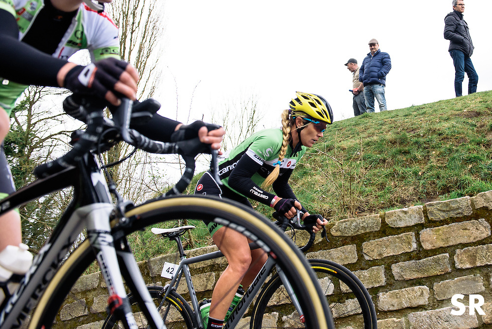 After her early solo attack, Alison Tetrick returns to the peloton on Muur van Geraardsbergen - Pajot Hills Classic 2016, a 122km road race starting and finishing in Gooik, on March 30th, 2016 in Vlaams Brabant, Belgium.