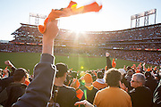 Giants fans wave orange rally towels during the NLCS Game 7 between the San Francisco Giants and the St. Louis Cardinals on Oct. 22, 2012 in San Francisco, Calif.  The Giants would go on to win, 9-0, making their second World Series appearance in 3 years.  Photo by Stan Olszewski/SOSKIphoto.