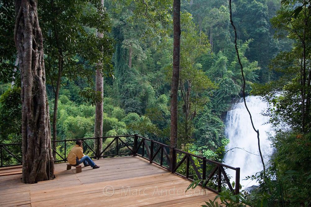 Woman looking at Siriphum (Sirithan) Waterfall, Doi Inthanon National Park, Thailand