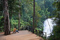 Woman looking at Siriphum (Sirithan) Waterfall, Doi Inthanon National Park, Thailand
