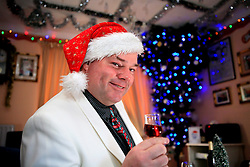 UK ENGLAND WILTSHIRE MELKSHAM 17DEC09 - Andy Park, self-proclaimed Mr Christmas celebrates Christmas every day at his home in Melksham, Wiltshire. ..Mr Park, a 45-year-old divorced electrician, has consumed nearly 118,000 brussel sprouts and about 5000 bottles of Moet champagne since he decided to get into the festive spirit full-time in July 1994...jre/Photo by Jiri Rezac..© Jiri Rezac 2009