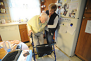 108-year-old WWII veteran, Bill Mohr is helped by home healthcare worker Susan Tedesco of Ambler, Pennsylvania in the kitchen of the home that he built for his wife Wednesday, November 9, 2016 in Hatboro, Pennsylvania. (Photo by William Thomas Cain)