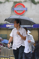 © Licensed to London News Pictures. 23/08/2018. London, UK. People shelter from the rain in Green Park as wet weather returns to central London. Photo credit: Rob Pinney/LNP