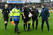 Blackpool caretaker manager David Dunn try to talk to referee Brett Huxtable as they walk off for half time after the sending off of Ben Heneghan (6) of Blackpool during the EFL Sky Bet League 1 match between Bristol Rovers and Blackpool at the Memorial Stadium, Bristol, England on 15 February 2020.