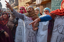 December 18, 2018 - Srinagar, Jammu & Kashmir, India - Kashmiri women are seen shouting Pro freedom slogans during a protest in Srinagar. Authorities imposed restrictions in many parts of the Kashmir valley to prevent the protest march called by Separatist leaders against the killings of seven civilians recently by Indian forces. (Credit Image: © Idrees Abbas/SOPA Images via ZUMA Wire)