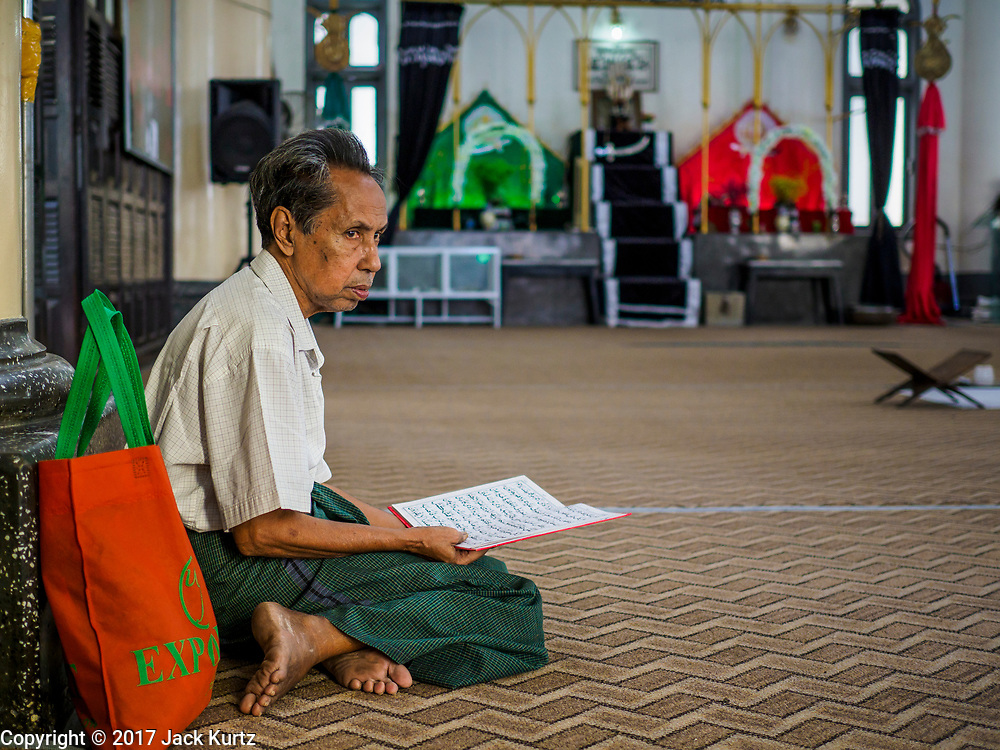 "24 NOVEMBER 2017 - YANGON, MYANMAR: A man prays in Mogul Shiah Mosque in Yangon. Many Muslims in overwhelmingly Buddhist Myanmar feel their religion is threatened by a series of laws that target non-Buddhists. Under the so called ""Race and Religion Protection Laws,"" people aren't allowed to convert from Buddhism to another religion without permission from authorities, Buddhist women aren't allowed to marry non-Buddhist men without permission from the community and polygamy is outlawed. Pope Francis is to arrive in Myanmar next week and is expected to address the persecution of the Rohingya, a Muslim ethnic minority in western Myanmar. Some Muslims and Christians are concerned that if the Pope's comments take too strong of pro-Rohingya stance, he could exacerbate religious tensions in the country.  PHOTO BY JACK KURTZ"