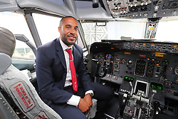 CARDIFF, WALES - Saturday, June 4, 2016: Wales' captain Ashley Williams in the cockpit as the team depart from Cardiff Airport heading to Sweden for their last friendly before the UEFA Euro 2016 in France. (Pic by David Rawcliffe/Propaganda)