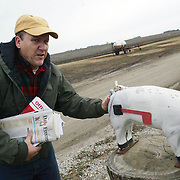 HOGS - WEBSTER CITY, DEC. 28 -- Hog producer Scott Tapper checks his mail Wednesday at his farm near Webster City.  Tapper will soon be president of the Iowa Pork Producers Association.  Photo by David Peterson