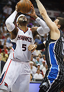 24 April 2011: Atlanta's Josh Smith (5) is being defended by Orlando's Hedo Turkoglu in Atlanta Hawks 88-85 victory over the Orlando Magic in Eastern Conference First Round Game 4 at Philips Arena in Atlanta, GA.