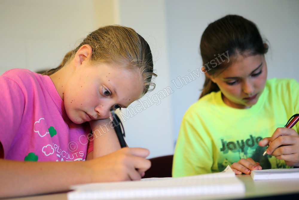 Students discuss and work on their writing during the Chippewa River Writing Camp photo by Emily Mesner